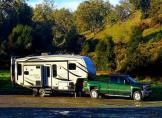 Buying an RV is a tough decision. When my friend purchased his 5th wheel motorhome I was so excited for him. He had no idea about RVlife, but he was about to. He was used to paying $3,000 a month for a downtown condo he never used. Last year he spent $3,500 total in campground rates for his 5th wheel to travel all around the country. His fifth wheel camper has everything. washer/dryer, dishwasher, solar, center kitchen island, bunk beds, mud room, outdoor kitchen, outdoor speakers, flat screen tvs and roof topdeck. when he bought his rv he bought the taj mahal trust me. The only problem with his RV is its big and luxurious.