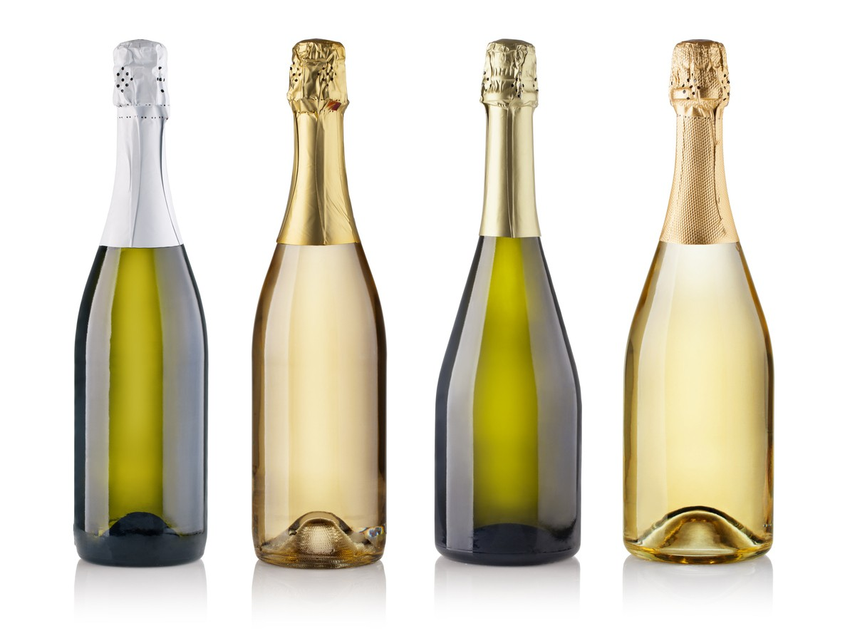 Sparkling Wine Closures- A.O. Wilson- Set of champagne bottles. isolated on white background