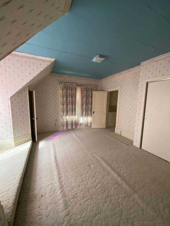 Bedroom featured at 121 E 12th St, Larned, KS 67550