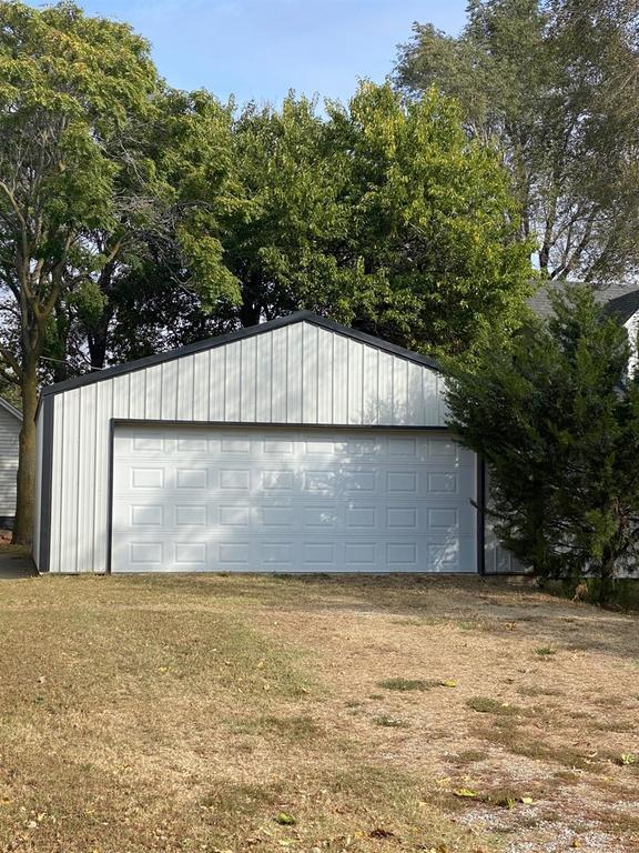 Garage featured at 121 E 12th St, Larned, KS 67550
