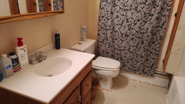 Bathroom featured at 14 Belmont St, Milo, ME 04463
