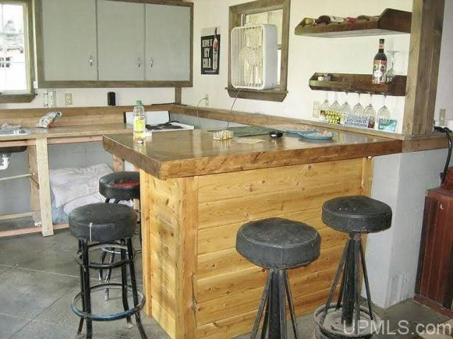 Kitchen featured at N16208 County Road 563, Spalding, MI 49886