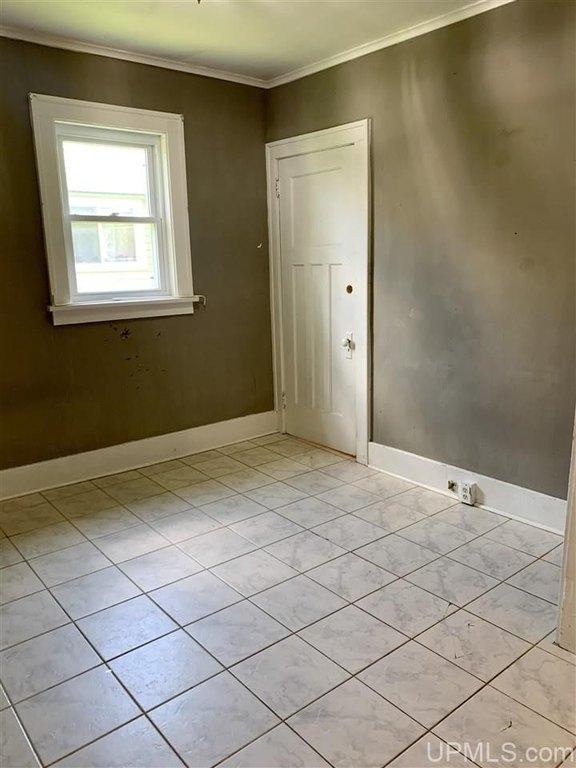 Bathroom featured at 737 Florence St, Ironwood, MI 49938