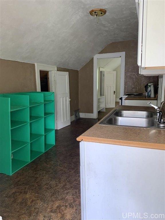Kitchen featured at 737 Florence St, Ironwood, MI 49938