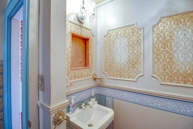Bathroom featured at 403 E 8th St, Alton, IL 62002