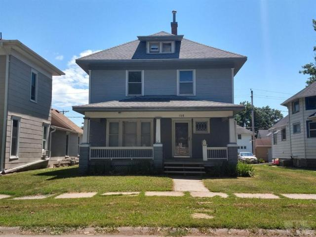 Porch yard featured at 108 E Grimes St, Red Oak, IA 51566