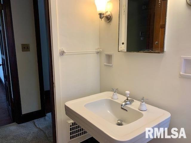 Bathroom featured at 1216 8th Ave S, Clinton, IA 52732
