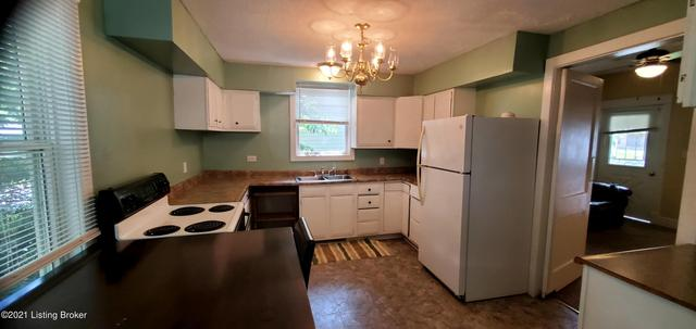 Kitchen featured at 1143 Louis Coleman Jr Dr, Louisville, KY 40211