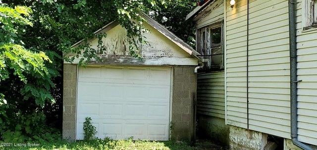 Garage featured at 1143 Louis Coleman Jr Dr, Louisville, KY 40211