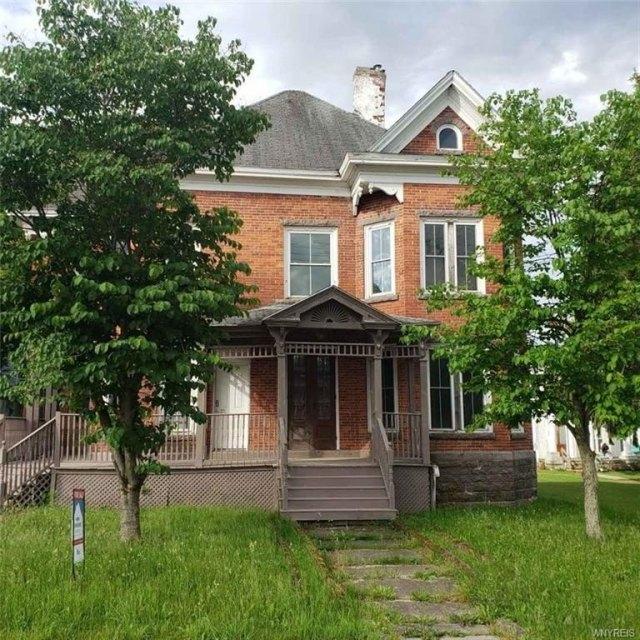 Porch yard featured at 207 Main St, Theresa, NY 13691