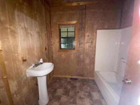 Bathroom featured at 31 County Road 267, Bruce, MS 38915