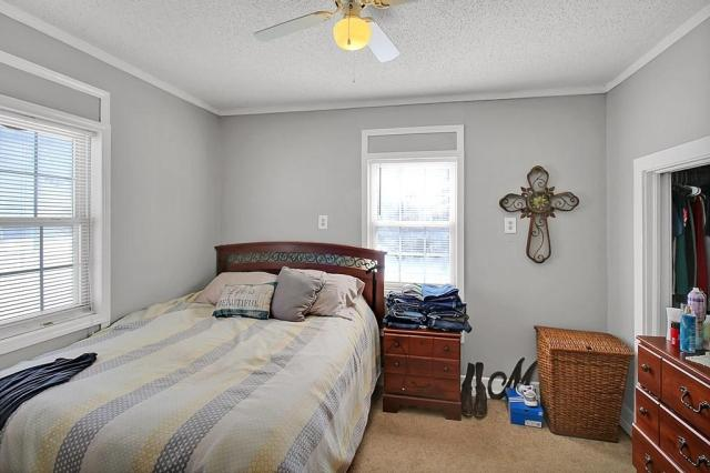 Bedroom featured at 414 N 24th St, Parsons, KS 67357