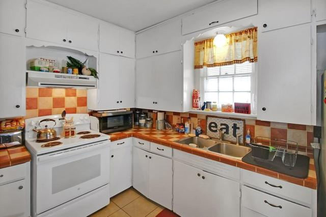 Kitchen featured at 414 N 24th St, Parsons, KS 67357