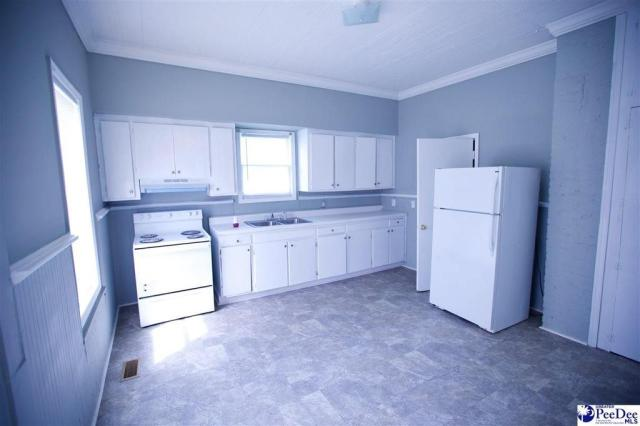 Kitchen featured at 1011 Carver St, Florence, SC 29501