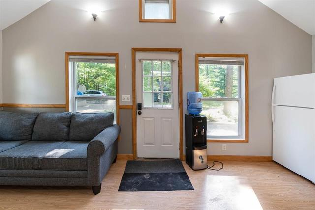 Living room featured at 4246 Gilding Rd, Beaverton, MI 48612