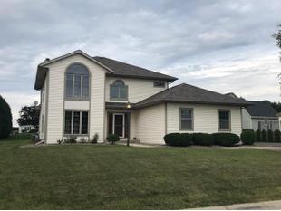 "<div></img>6410 Anforest Ln</div><div>Mount Pleasant, Wisconsin 53406</div>"" data-original=""/img/cdn/assets/layout/patch_white_bg.jpg""></a></figure><div class="