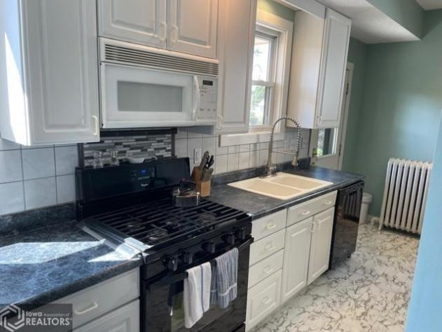 Kitchen featured at 807 N 8th St, Burlington, IA 52601