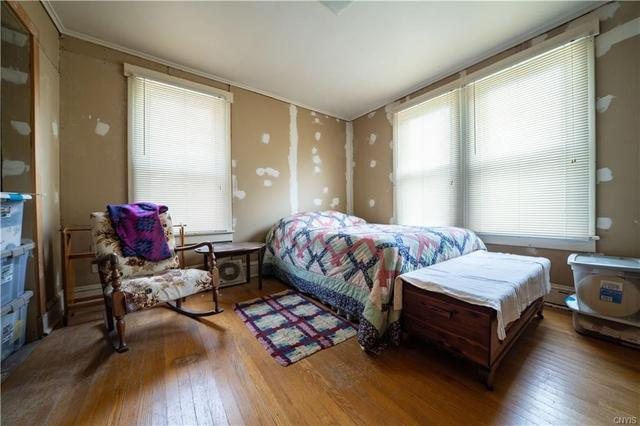 Bedroom featured at 12 Rundell St, Dolgeville, NY 13329
