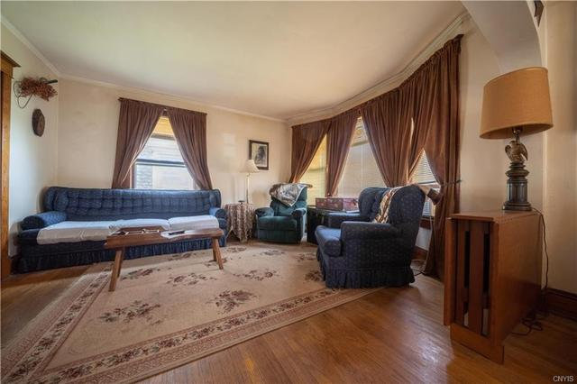 Living room featured at 12 Rundell St, Dolgeville, NY 13329