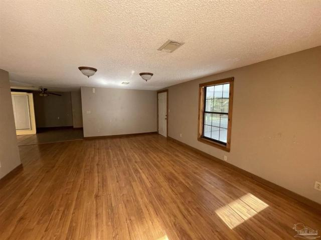 Living room featured at 4560 Trice Rd, Milton, FL 32571