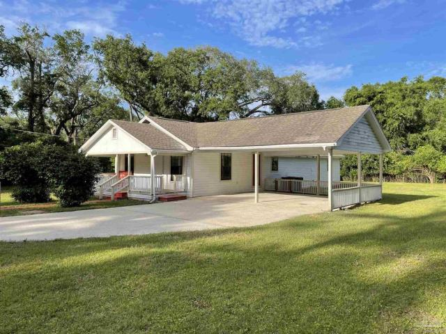 Porch yard featured at 4560 Trice Rd, Milton, FL 32571