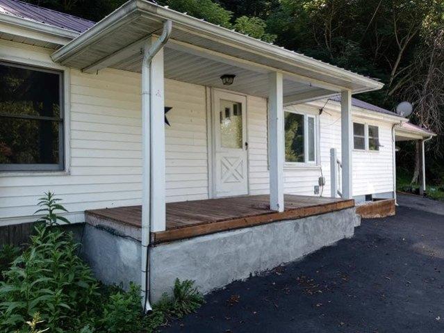 Porch featured at 1097 Glacier St, Grundy, VA 24614
