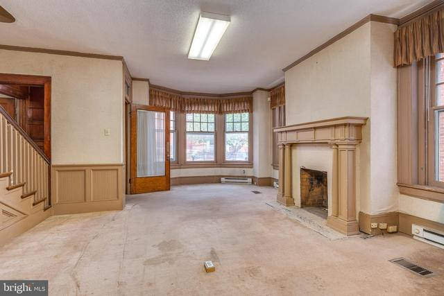 Living room featured at 219 W Burke St, Martinsburg, WV 25401