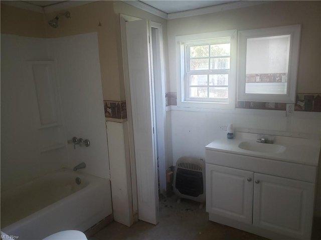 Bathroom featured at 296 Washington St, Elizabeth, WV 25270