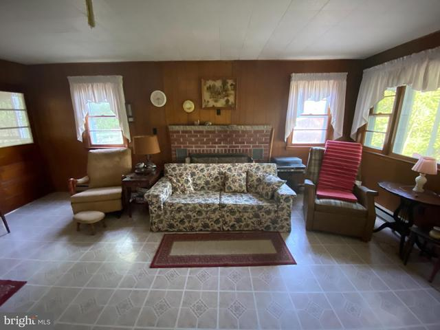 Living room featured at 20728 S Fork Rd, Moorefield, WV 26838