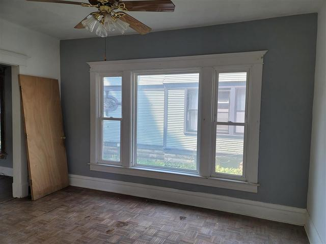 Bedroom featured at 1220 W 3rd St, Waterloo, IA 50701