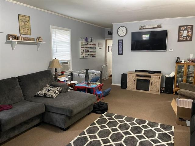 Living room featured at 310 E 1st St, Corning, NY 14830