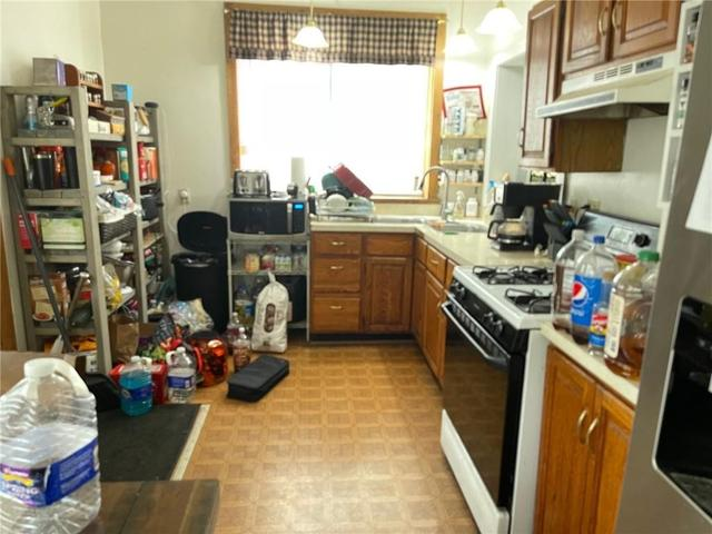 Laundry room featured at 310 E 1st St, Corning, NY 14830