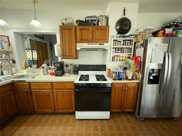Kitchen featured at 310 E 1st St, Corning, NY 14830