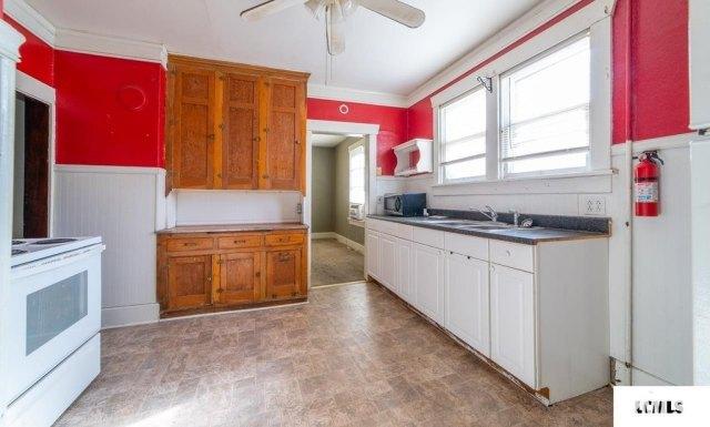 Kitchen featured at 213 N Bogardus St, Elkhart, IL 62634