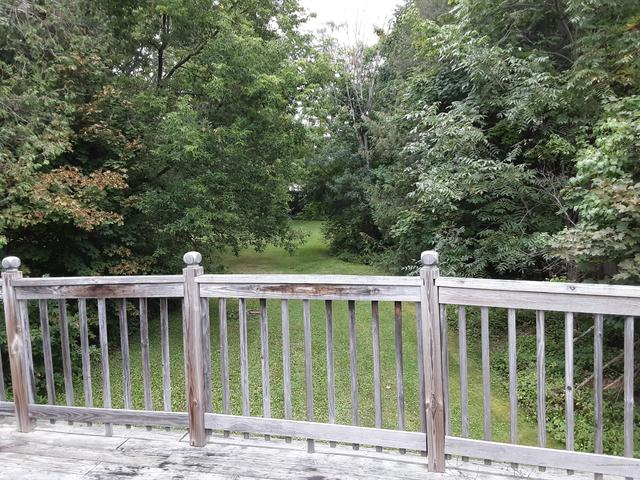 Porch yard featured at 11 Elm St, Houlton, ME 04730