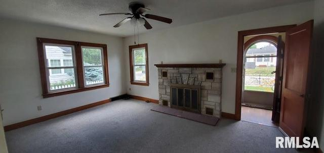 Living room featured at 1218 S 10th St, Clinton, IA 52732