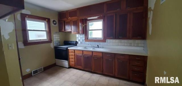 Kitchen featured at 1218 S 10th St, Clinton, IA 52732