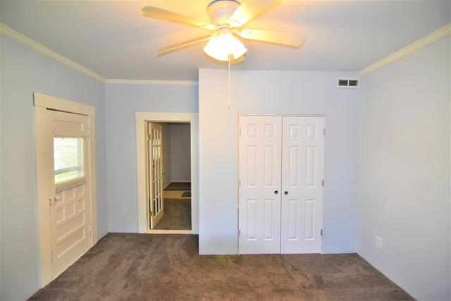 Bedroom featured at 607 N Monroe St, Carrollton, MO 64633