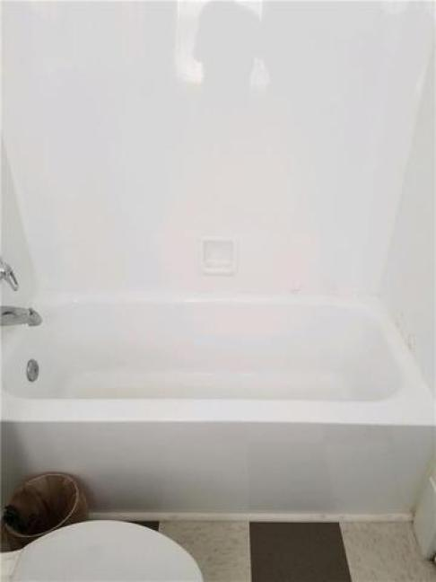 Bathroom featured at 1046 N Hill Ave, Decatur, IL 62522