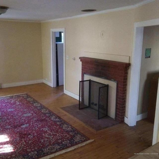 Living room featured at 71 N Main St, Andover, ME 04216