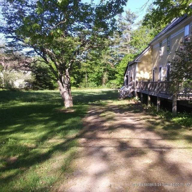 Yard featured at 71 N Main St, Andover, ME 04216