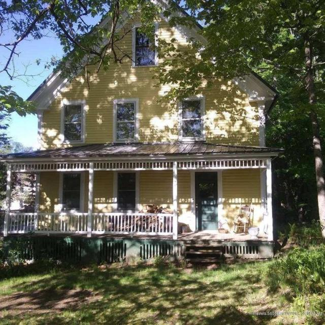 Porch yard featured at 71 N Main St, Andover, ME 04216