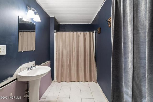 Bathroom featured at 716 Hallsboro Rd N, Clarkton, NC 28433