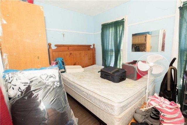 Bedroom featured at 205 Barrett St, Syracuse, NY 13204