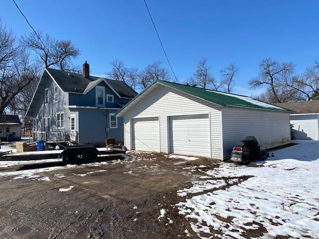 Garage featured at 716 W 5th St, Madison, MN 56256