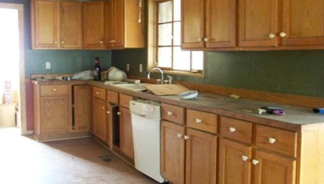 Kitchen featured at 18 S Wilson Ave, Chanute, KS 66720