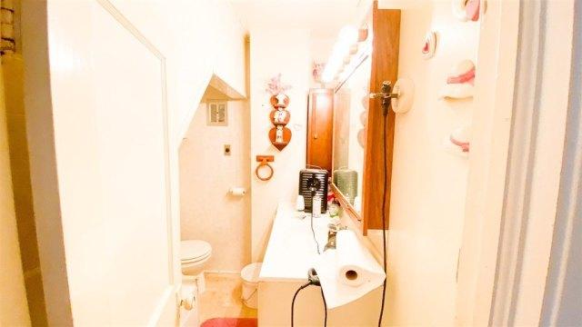 Bathroom featured at 600 N Main St, Columbus, ND 58727