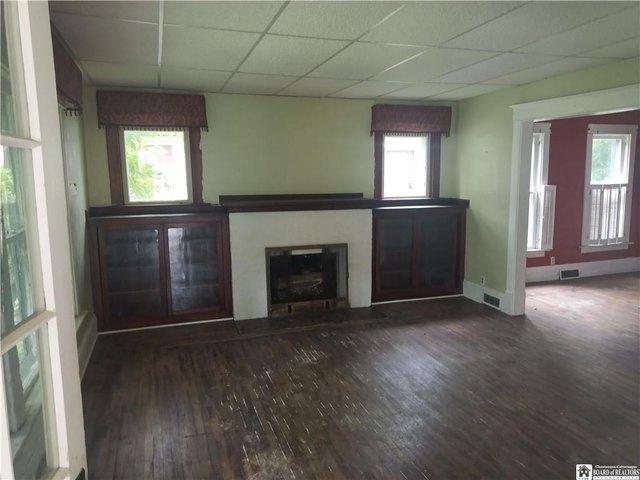 Living room featured at 40 Swan St, Salamanca, NY 14779