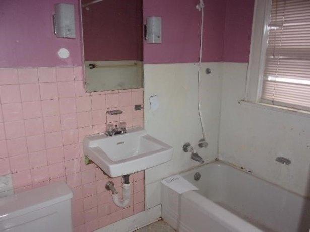 Bathroom featured at 311 E Charles St, Oelwein, IA 50662