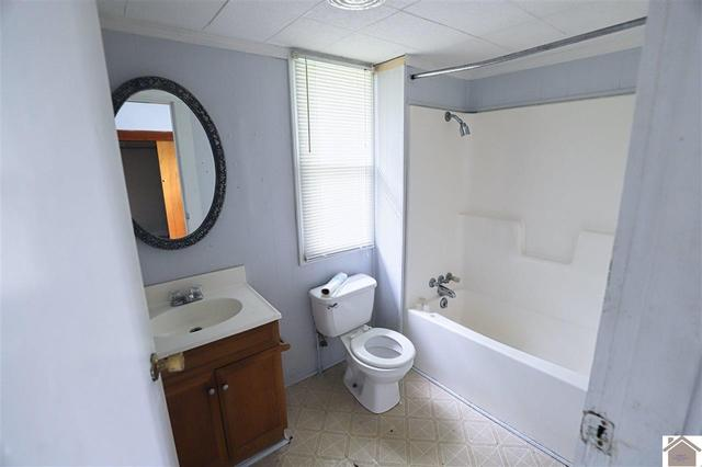 Bathroom featured at 1315 N 13th St, Paducah, KY 42001